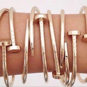 Trendy gold nail bracelet.